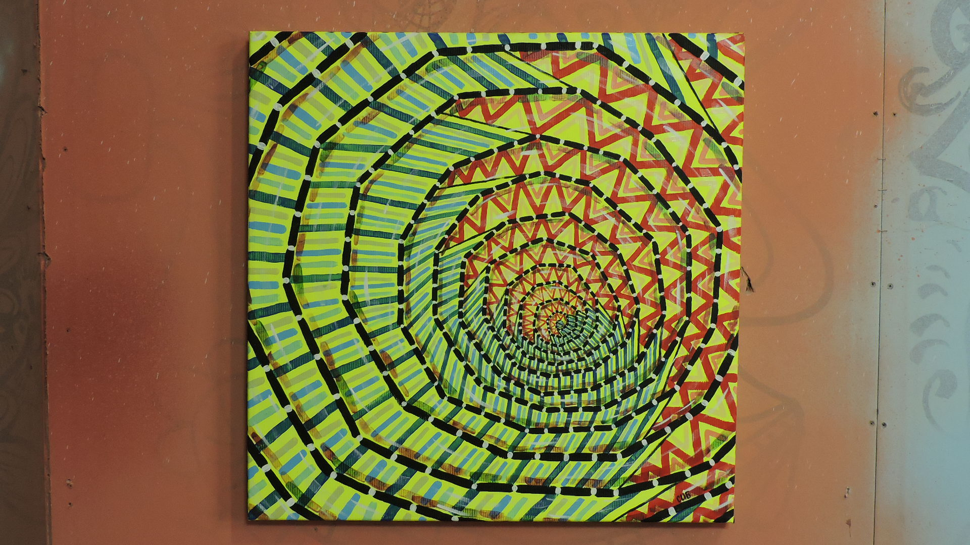 On the canvas painted a bright spiral on a fluorescent yellow background
