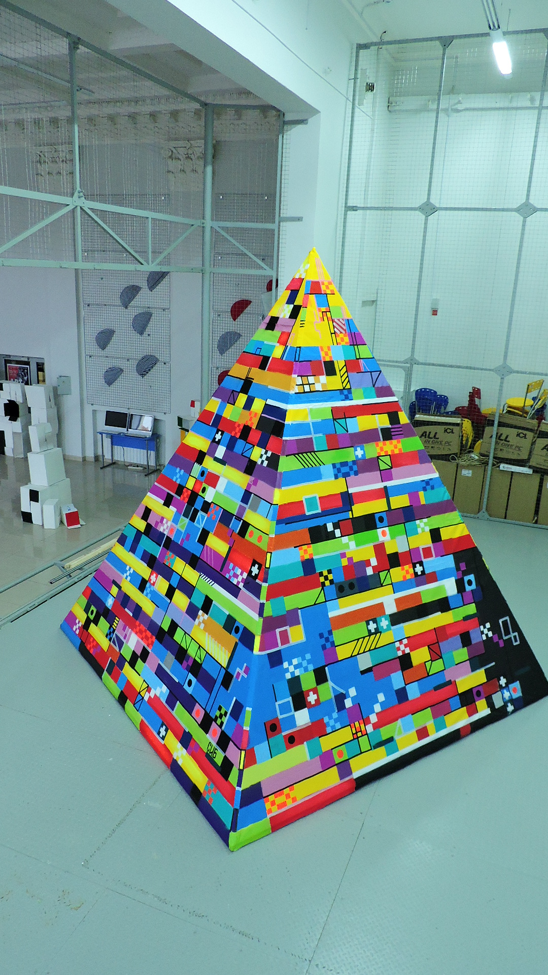 The pyramid is assembled from a rigid frame and PVC fabric.