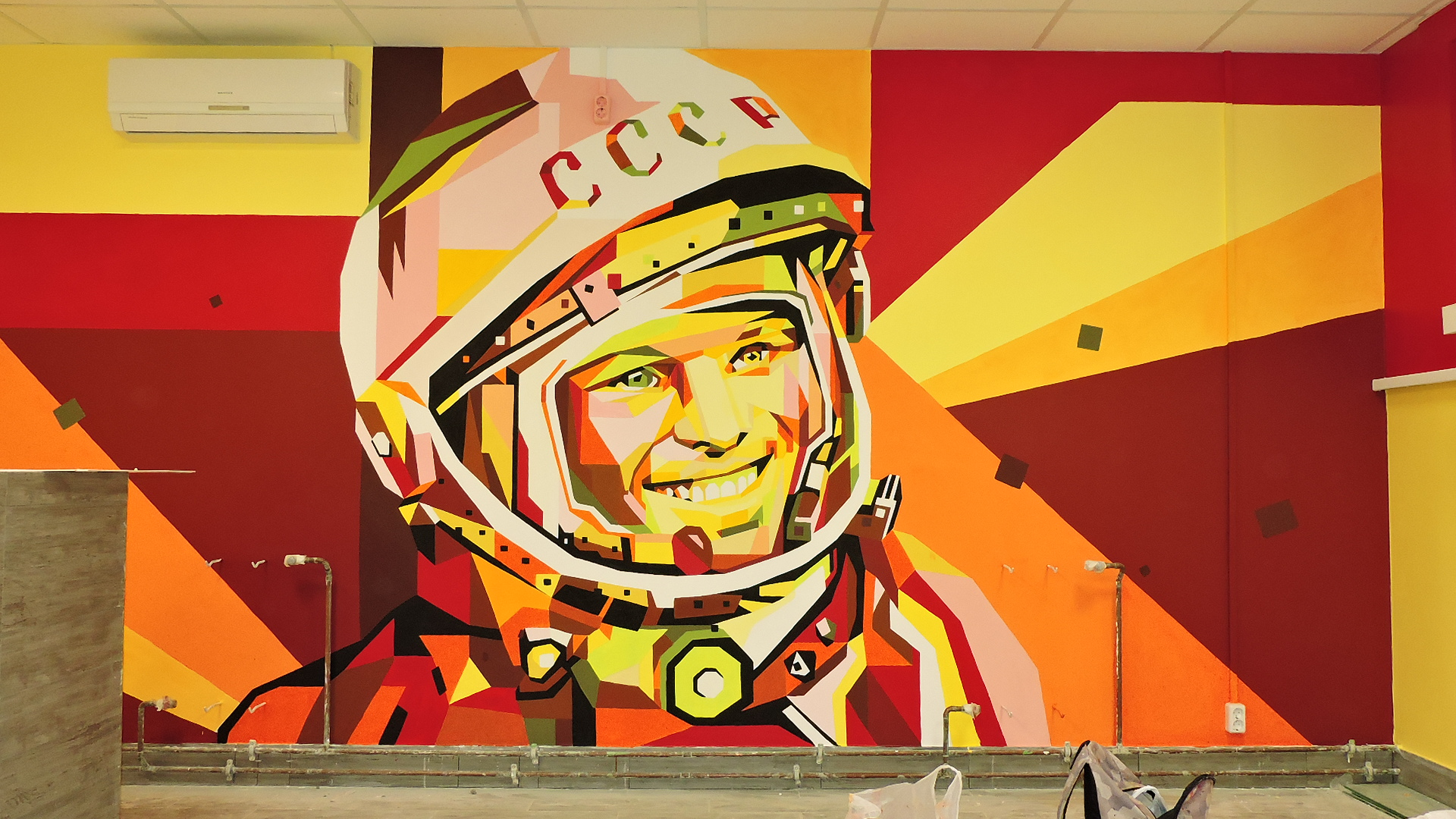 On the wall painted Gagarin's face in a spacesuit
